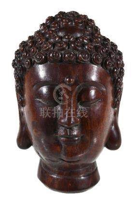 A Chinese wood Buddha head, possibly aloeswood, the head with carved tight curls, 25.5cm high, 1,482