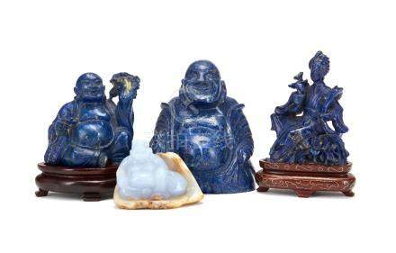 A Chinese Chalcedony carving of a Buddha, carved with light purple coloured stone against a