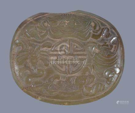 A Chinese celadon jade oval plaque, probably 19th century, 8.5cm wide x 7.2cm high