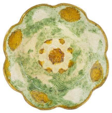 A MOULDED SANCAI-GLAZED POTTERY DISH, LIAO DYNASTY (907-1125)