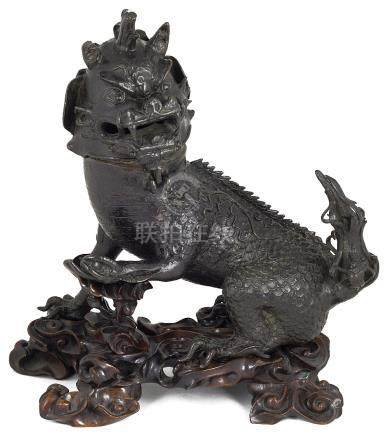 A CHINESE BRONZE QILIN INCENSE BURNER, 17TH / 18TH CENTURY