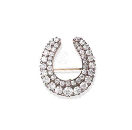 A diamond horseshoe pendant/brooch,