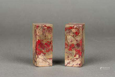 A PAIR OF 'CHICKEN BLOOD' STONE SEALS