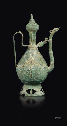 A verdigris bronze pitcher in an Arab-style shape with