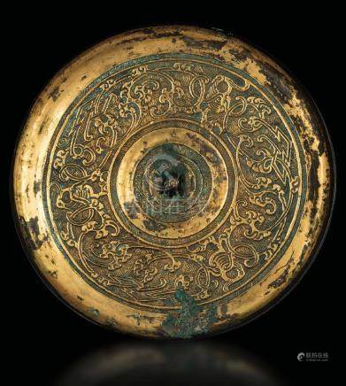 A gilt bronze mirror with embossed decors, China, Han
