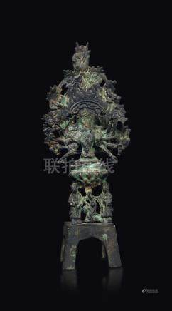 A bronze figure of Buddha seated on a lotus flower on a