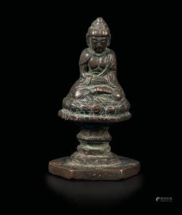 A semi-gilt bronze Sakyamuni figure, China, Ming