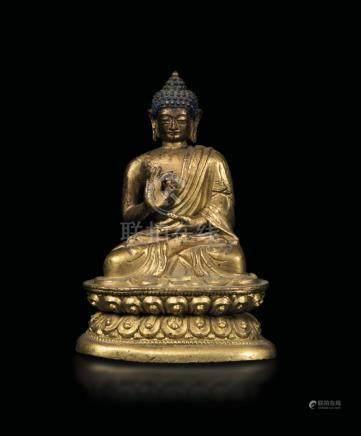 A gilt bronze figure of Buddha Sakyamuny seated on a