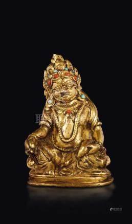 A gilt bronze figure of Sita-Jambhala with coral and