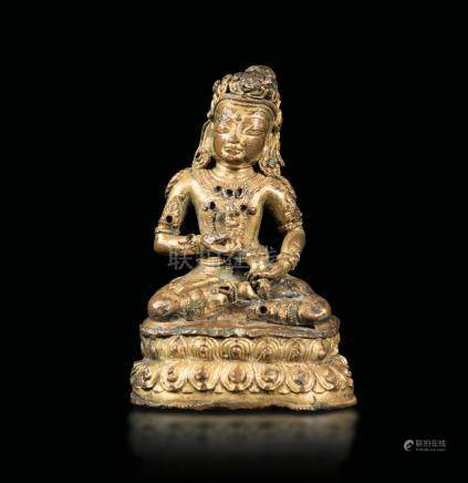 A Tara figure seated on a double lotus with