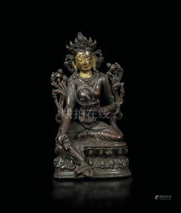 A semi-gilt bronze figure of a Green Tara seated on a