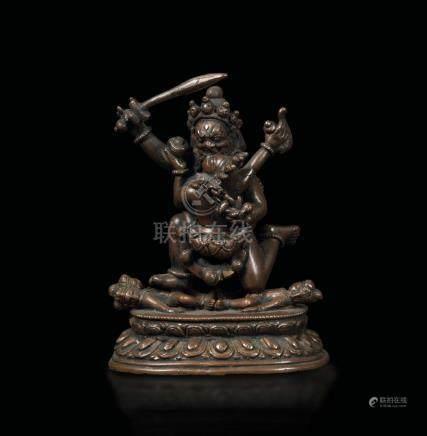 A bronze figure of Rakta-Yamari on a double lotus