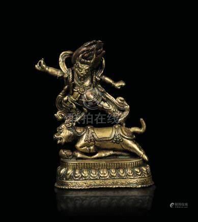 A gilt bronze figure of Dharmapala Santi-Yama on a