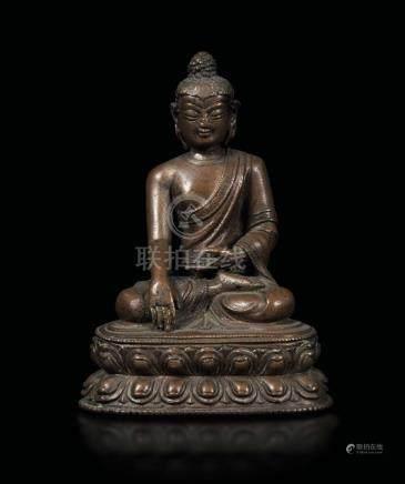 A bronze figure of Buddha Sakyamuny seated on a double