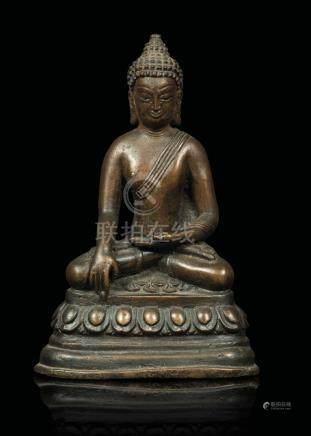 A bronze figure of a Buddha Sakyamuny seated on a lotus