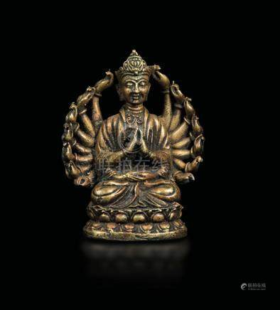 A bronze figure of Lama seated on a double lotus