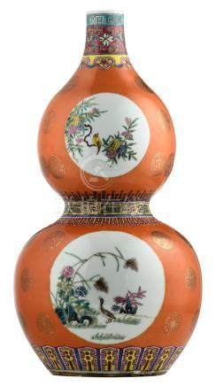 A Chinese orange ground famille rose double gourd vase, the roundels decorated with birds and flower branches, marked, H 43,5 cm