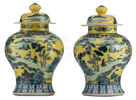 A pair of Chinese yellow ground polychrome vases and covers, overall decorated with figures in a mountainous river landscape, about 1900, H 39,5 cm