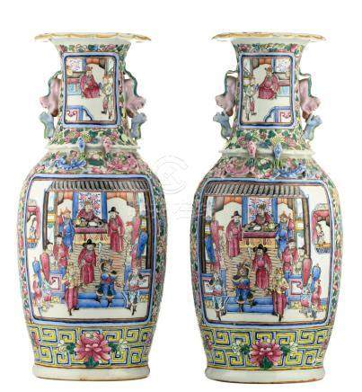 A pair of Chinese famille rose floral decorated vases, the roundels with warriors and court scenes, 19thC, H 58 cm