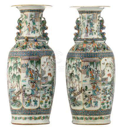 Two Chinese famille verte and polychrome relief decorated vases, the panels with animated scenes, birds and flower branches, 19thC, H 61 cm