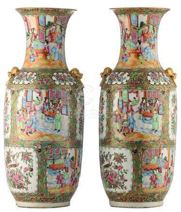 A pair of Chinese Canton famille rose floral decorated vases, the roundels with various court scenes, birds and butterflies on flower branches, 19thC, H 62 cm