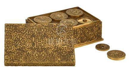A fine Chinese basso relievo worked bronze three-part collector's box and cover with inside a compilation of ancient coin replica's, with a Qianlong mark, H 9 – W 22 – D 15 cm