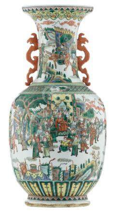 A large Chinese famille verte baluster shaped vase, overall decorated with warriors and a court scene, the handles dragon shaped, H 80,5 cm