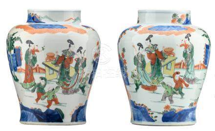 A pair of Chinese wucai vases, overall decorated with ladies and playing children in a garden, H 31,5 cm