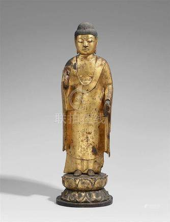 A wood and gilt lacquer figure of Amida Nyorai. In the style