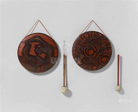 Two copper gongs, each with a striker. 19th/20th century