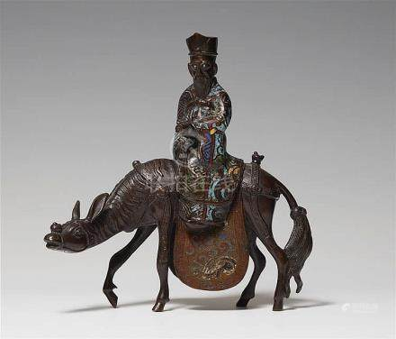 A bronze and enamel champlevé figure on a donkey. Late 19th