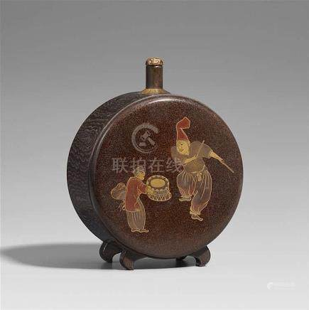 A lacquered wood sake bottle. 19th century