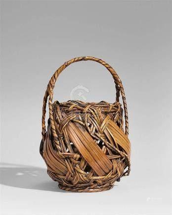 A bamboo ikebana basket. 20th century