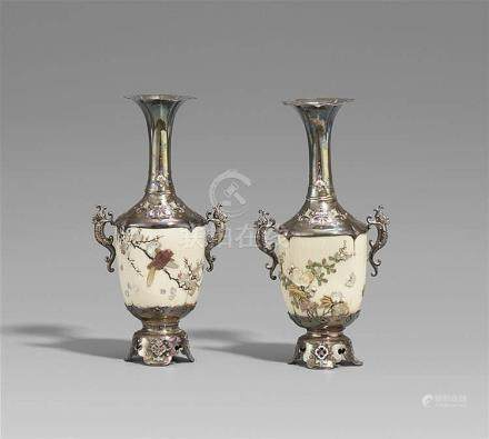 A pair of silver and ivory Shibayama vases. Late 19th centur