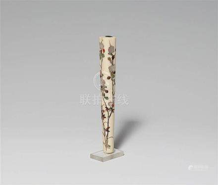 An ivory Shibayama umbrella handle. Late 19th century