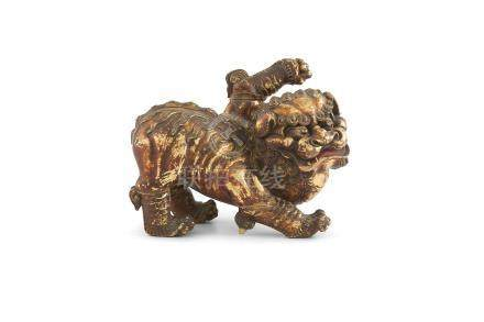 A CHINESE 19TH CENTURY CARVED GILTWOOD MODEL OF A KYLIN, modelled standing with one raised paw. 22cm
