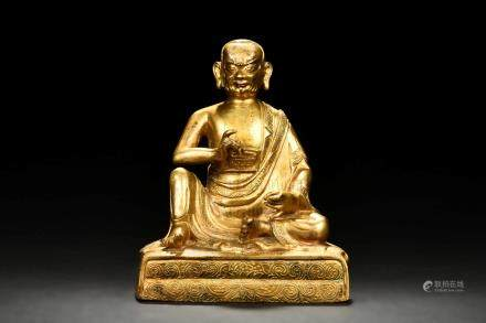 GILT BRONZE SEATED MAHASIDDHA FIGURE