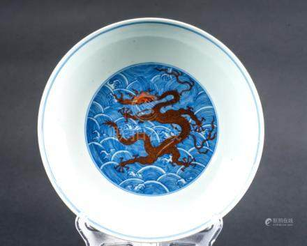 Chinese Art A blue and white dish painted with a red dragon