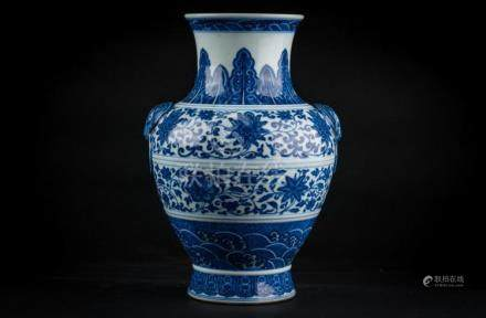 Chinese Art A blue and white vase painted with lotus flowers