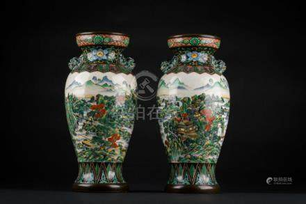 Chinese Art A pair of Kutani pottery vases bearing a two cha