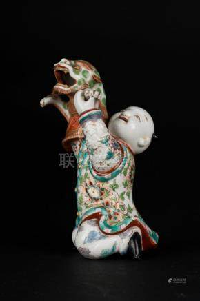 Chinese Art An enamelled pottery figure depicting a boy and