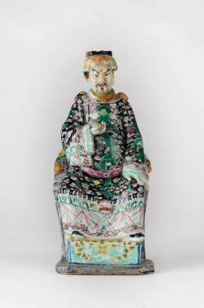 Chinese Art An enamelled porcelain figure of a seated dignit