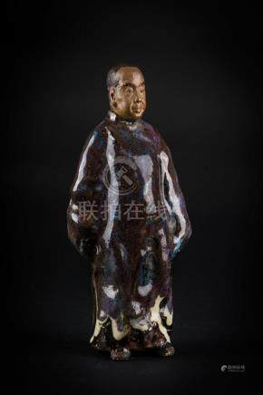 Chinese Art A glazed earthenware figure of a standing dignit