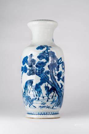 Chinese Art A blue and white vase decorated with deers and b