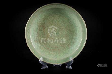 Chinese Art A celadon pottery dish engraved with clouds and