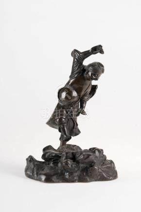 Chinese Art A dark bronze figure of the Daoist immortal Liuh