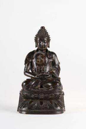 Chinese Art A dark bronze figure of Amitabha bearing a long