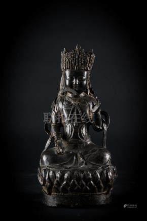 Chinese Art A dark bronze figure of a seated bodhisattva Chi