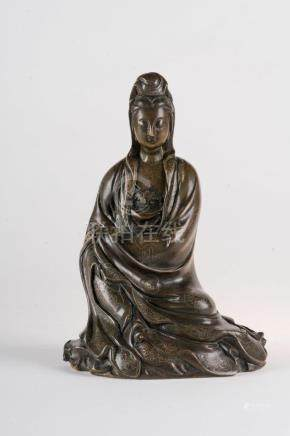 Chinese Art A dark bronze figure of seated Guanyin decorated