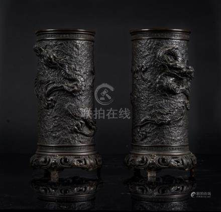 Japanese Art A pair of dark bronze vases decorated with drag